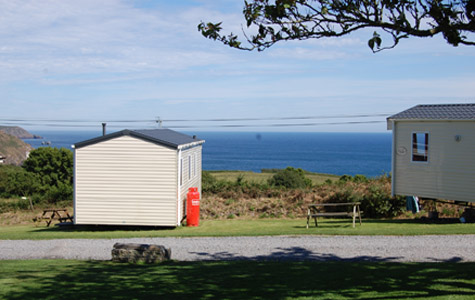 Caravans and sea view from the park